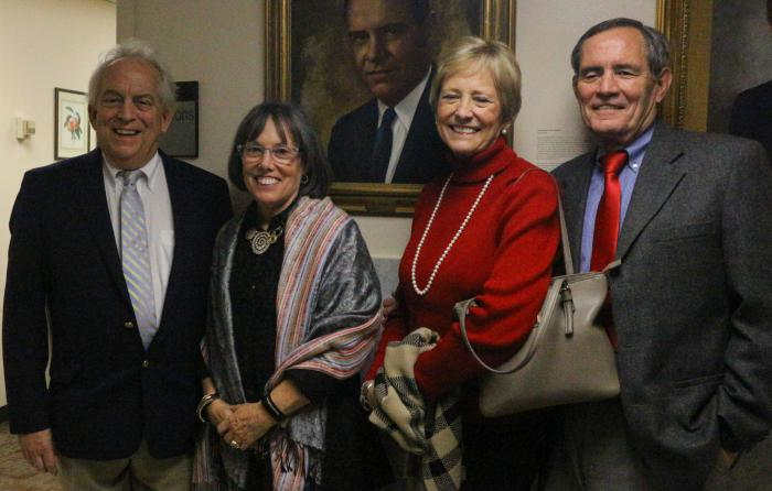 Four of the six children of former Georgia Agriculture Commissioner Phil Campbell pose with his portrait at the Georgia Department of Agriculture. They are, from left: Alan Campbell, Jennifer Campbell Foy, Anne Campbell Prichard and Jay Campbell.