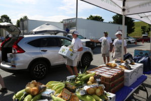 Staff load a truck with a mixed produce box